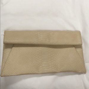 Tan python envelope clutch